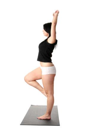 corpulent: Corpulent woman training yoga, over white background Stock Photo