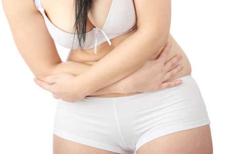 beleibt: Junge Korpulente caucasian Frau in Unterw�sche mit Bauchschmerzen