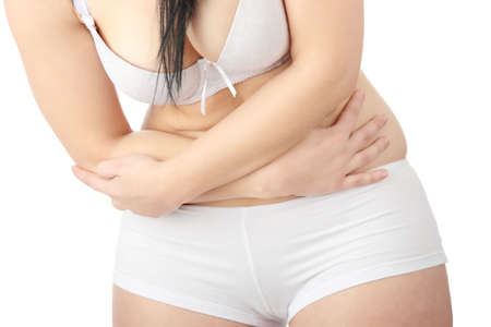 Young corpulent caucasian woman in underwear with stomach ache  photo