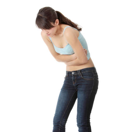 wanorde: Jonge teen vrouw met maag ache geïsoleerd op witte achtergrond  Stockfoto