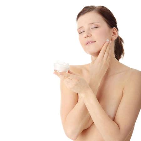 Woman applying moisturizer cream on face. Close-up fresh woman face. Stock Photo - 6599159
