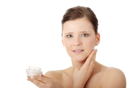 Woman applying moisturizer cream on face. Close-up fresh woman face.  Stock Photo - 6599312