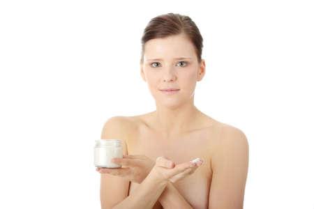 Woman applying moisturizer cream on face. Close-up fresh woman face. Stock Photo - 6599141