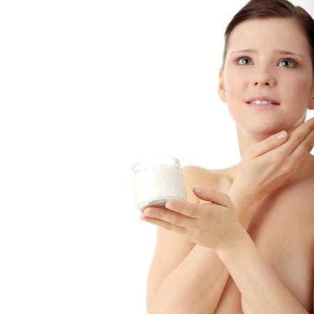 Woman applying moisturizer cream on face. Close-up fresh woman face. Stock Photo - 6599084