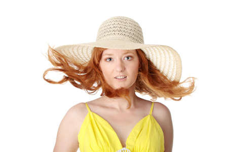 Redhead girl in yellow summer dress and hat, isolated on white photo
