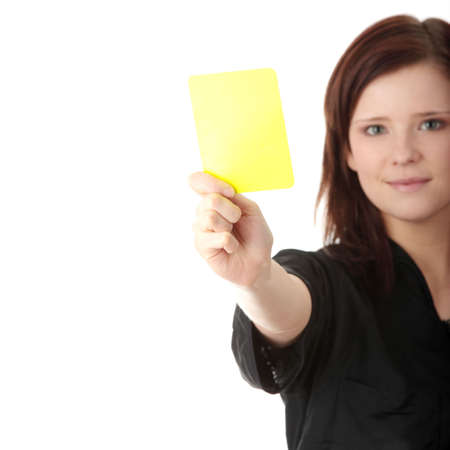 sacked: Young female referee showing the red card, isolated on white Stock Photo