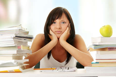 Young woman studying at the desk  photo