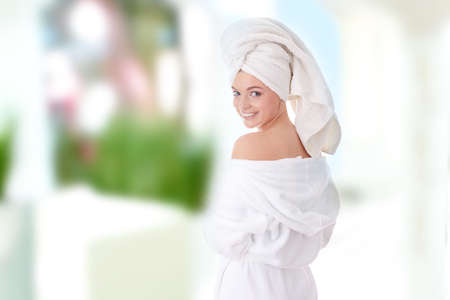 Young beautiful caucasian woman after bath photo