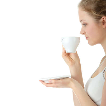 Young attractive blond woman drinking coffee, isolated on white background  photo