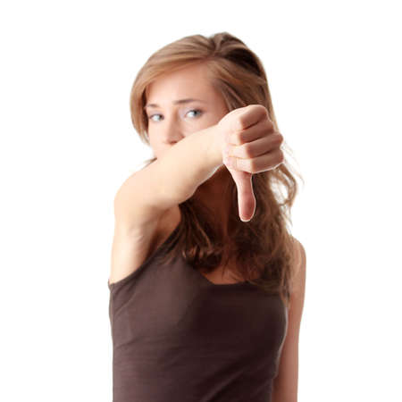 disapprove: Young woman showing thumbs down isolated