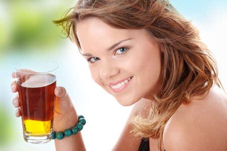 Young woman in bikini drinking ice tea isolated photo