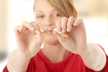 quiting smoking: Young caucasian woman quiting smoking isolated