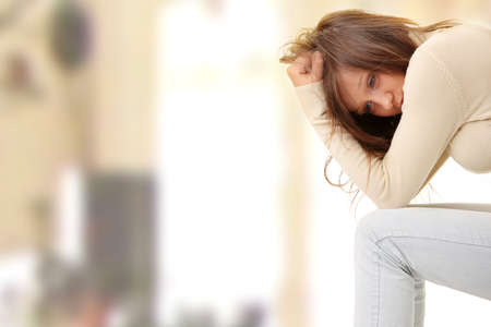 Teenage girl depression - lost love - isolated on white background photo