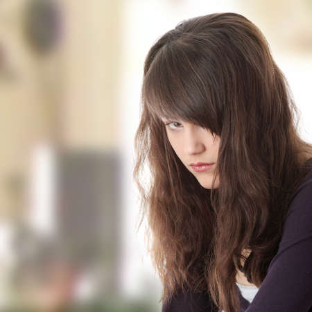 Young teen woman with depression photo