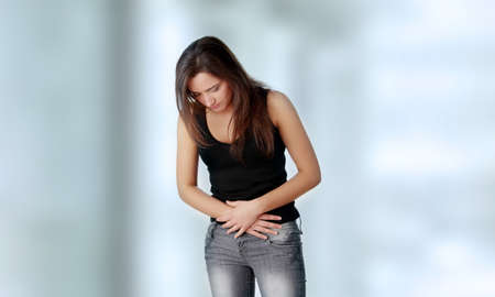 stomachache woman: Young woman with stomach issues Stock Photo