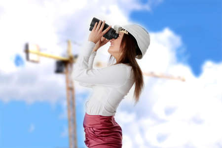 Business vision concept, enginer woman looking throught binoculars  photo