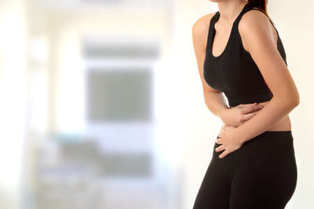 cramping: Young woman with stomach issues  Stock Photo