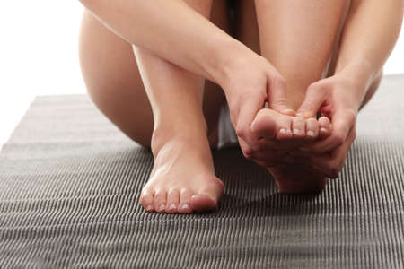 female feet: Woman touching her leg - pain concept