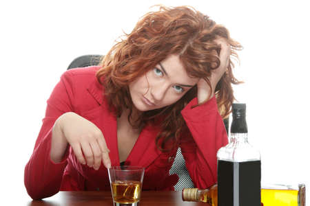 irresponsible: Alone young woman in depression, drinking alcohol (burbon)