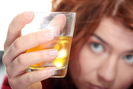 alcoholic drinks: Alone young woman in depression, drinking alcohol (burbon)