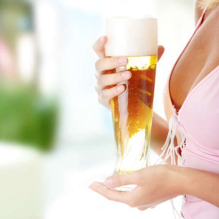 Young atractive blonde in sexy lingerie holding a beer Stock Photo - 6939742