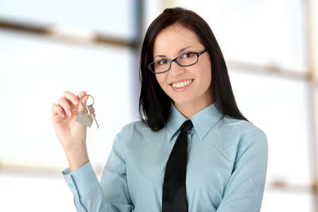 doorkey: Young businesswoman  (real estate agent) with kay Stock Photo