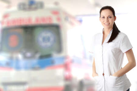 h1n1 vaccinations: Young nurse or female doctor , with ambulance in background Stock Photo