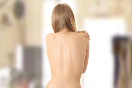 Woman from behind, naked body, pain concept photo