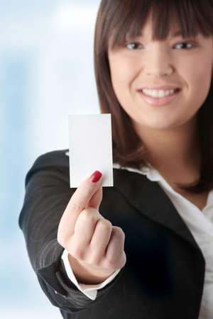 inquiring: Portrait of a beautiful businesswoman holding a white card.