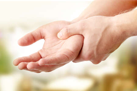 Man holding his hand - pain concept Stock Photo - 6932378