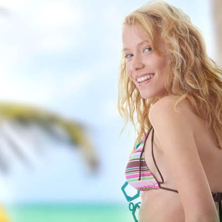 Young beautiful happy blond woman in colorful top of bikini  (summer concept)  photo