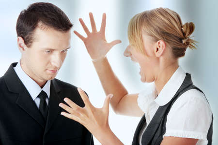 Two work colleagues arguing (male and female) photo