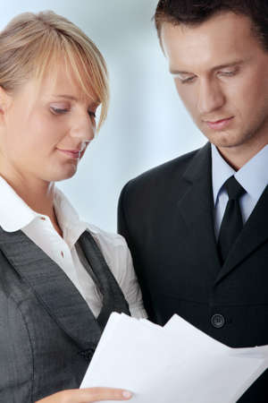 Young attractive business people isolated Stock Photo - 7816433