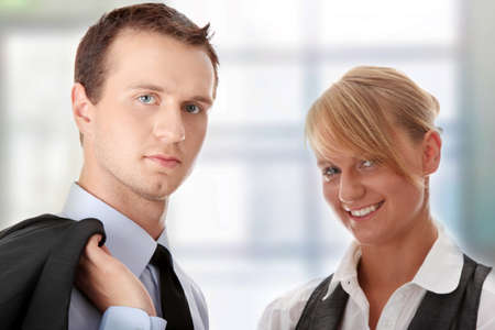 Young attractive business people isolated Stock Photo - 6954676
