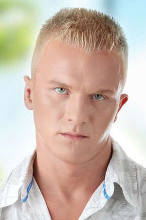 european expression face: Casual young man portrait outdoor