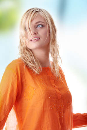 Beautiful woung  teen woman in orange shirt photo