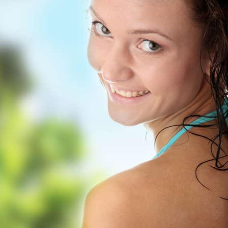 Young wet woman in blue bikini  photo