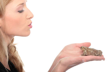 prince charming: A gorgeous young blond woman kissing a frog Stock Photo