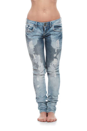 Young woman body in jeans - wet because of pee  shock, scare,illness or laughing   photo