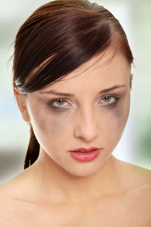Abused woman crying over white background  photo