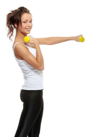 Portrait of beautiful young woman with dumbbells Stock Photo - 6932900