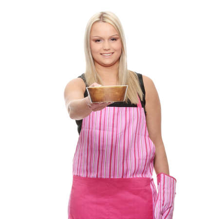 Young beautiful female cook, isolated on white Stock Photo - 6933131