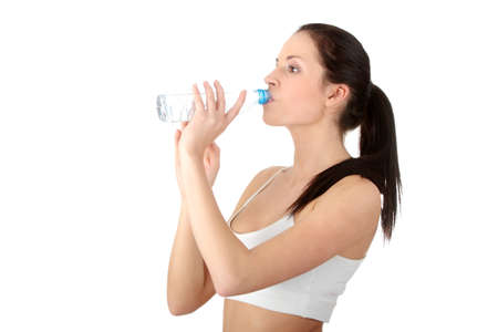 plactic: Young woman drinking water from plactic bottle Stock Photo