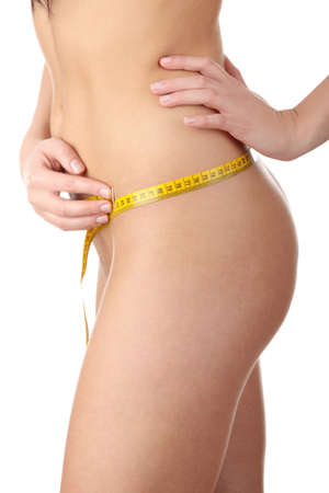 healthy body: The beautiful girl measures her body on a white background. Healthy lifestyles concept.