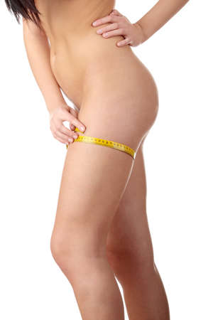 body line: The beautiful girl measures her body on a white background. Healthy lifestyles concept.