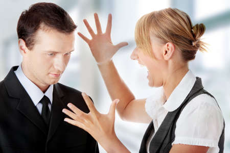 mobbing: Work Colleagues arguing on white background Stock Photo
