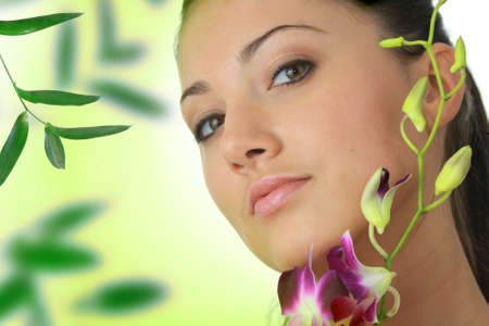 Beauteful spa girl with orchid photo