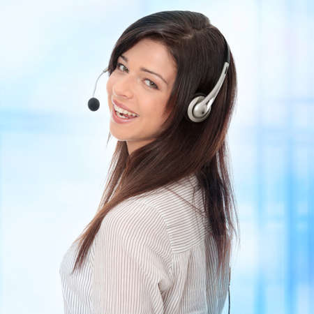 Call center woman with headset. Over abstract blue background Stock Photo - 7505189