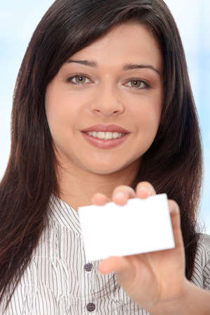 Beautiful businesswoman with business card, Over abstract blue background  photo