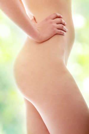 naked belly: Close up photo of nude body of young fit female, isolated on white